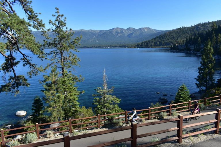 solo rider on East Shore bike trail along lake tahoe